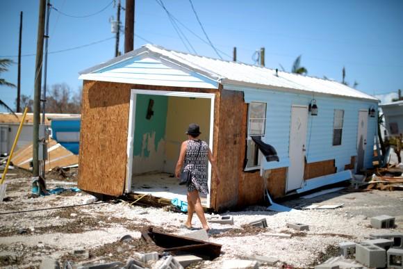 Lora Castelo walks by her destroyed trailer home after Hurricane Irma struck Florida, in Islamorada, U.S., September 12, 2017. (Reuters/Carlos Barria)