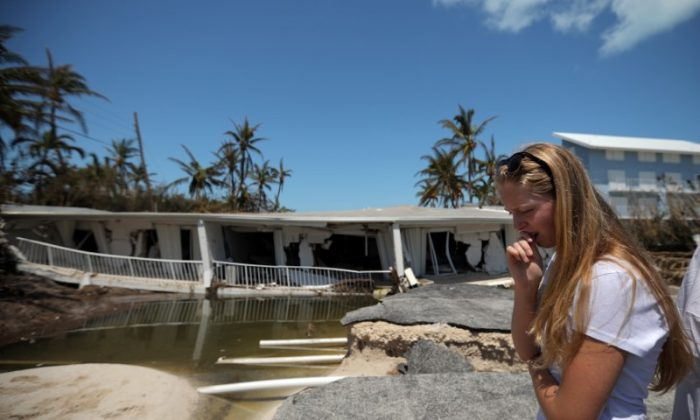 A local resident reacts as she sees the damage on her home after Hurricane Irma struck Florida, in Islamorada Key, U.S., September 12, 2017. (Reuters/Carlos Barria)