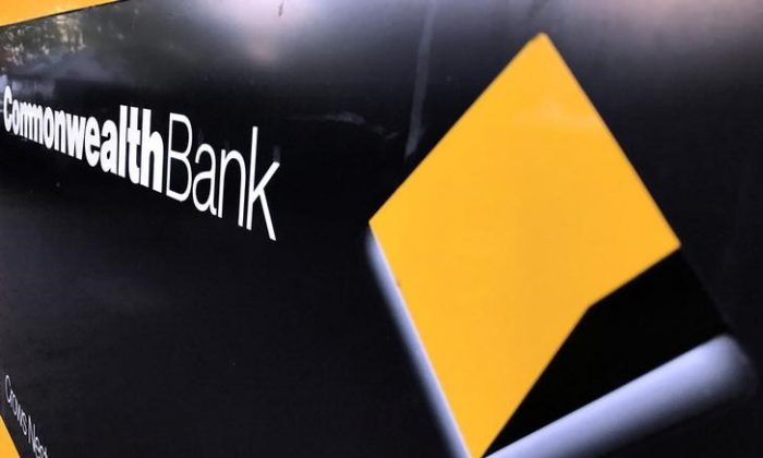 A Commonwealth Bank of Australia logo adorns the wall of a branch in Sydney, Australia, May 8, 2017. (David Gray/File Photo/Reuters)