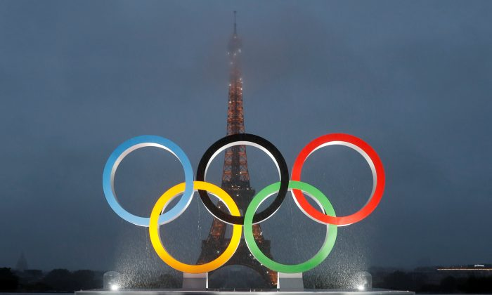 Olympic rings to celebrate the IOC official announcement that Paris won the 2024 Olynpic bid are seen during a ceremony at the Trocadero square in Paris, France on Sept.13, 2017 . (REUTERS/Gonzalo Fuentes)