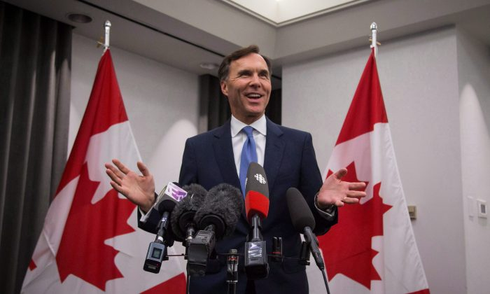 """Minister of Finance Bill Morneau holds a press conference in Vancouver on Sept. 5, 2017. The trip to B.C. is part of a cross-Canada """"listening tour"""" concerning proposed tax changes that will affect small business. (The Canadian Press/Ben Nelms)"""