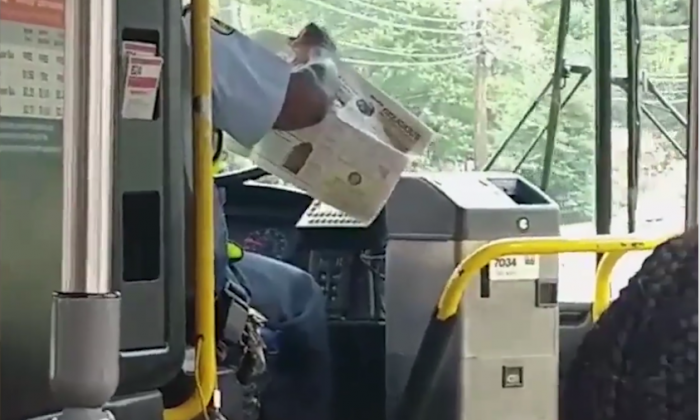 A metro bus driver in Maryland has been suspended after being videoed reading a newspaper while driving (Myles Hill)