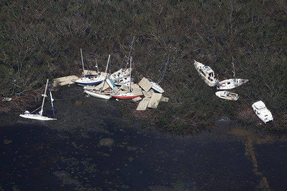 Boats are pictured washed ashore in an aerial photo in the Keys in Marathoni, Florida, U.S., September 13, 2017. REUTERS/Carlo Allegri