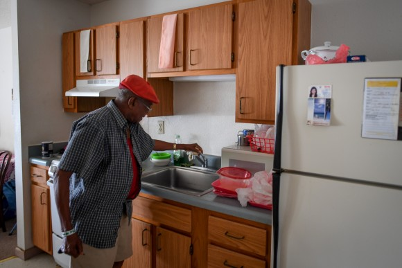 Two days after Hurricane Irma caused a power and water outage, William James, 83, checks the faucet for water, in his room at Cypress Run, an assisted living facility, in Immokalee, Florida, U.S., September 12, 2017. Picture taken September 12, 2017. REUTERS/Bryan Woolston