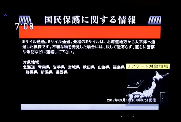 The Japanese government's alert message, called J-alert, notifying citizens of a ballistic missile launch by North Korea is seen on a television screen in Tokyo, Japan Sept. 15. (REUTERS/Issei Kato)