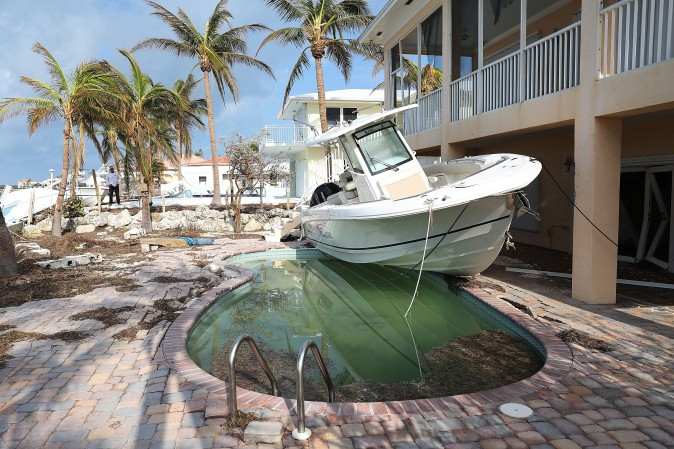 A boat is next to a home after Hurricane Irma passed through Duck Key, Fla., on Sept. 13. (Joe Raedle/Getty Images)