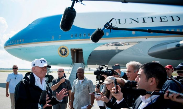 US President Donald Trump speaks to the press on arrival in Fort Myers, Florida, on September 14, 2017. He addresses questions about whether his tax reform plan would benefit the high-income households. (BRENDAN SMIALOWSKI/AFP/Getty Images)