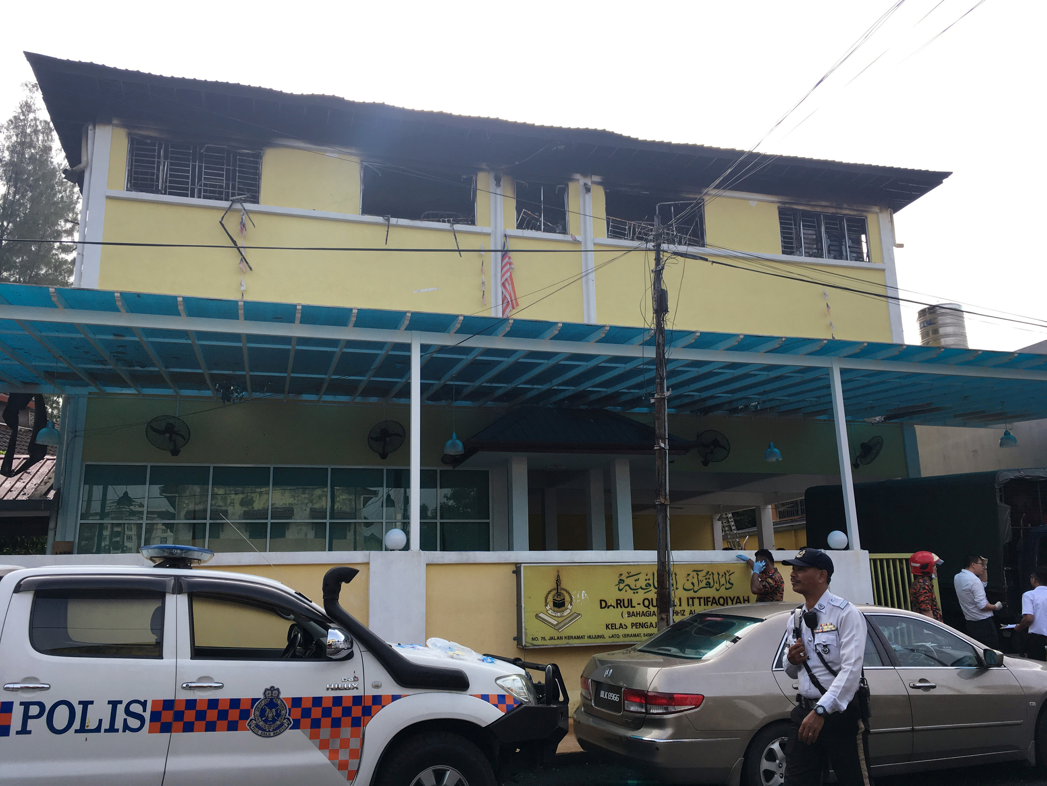 Police and fire department work at the religious school Darul Quran Ittifaqiyah after a fire broke out in Kuala Lumpur, Malaysia on Sept. 14, 2017. (REUTERS/A. Ananthalakshmi)