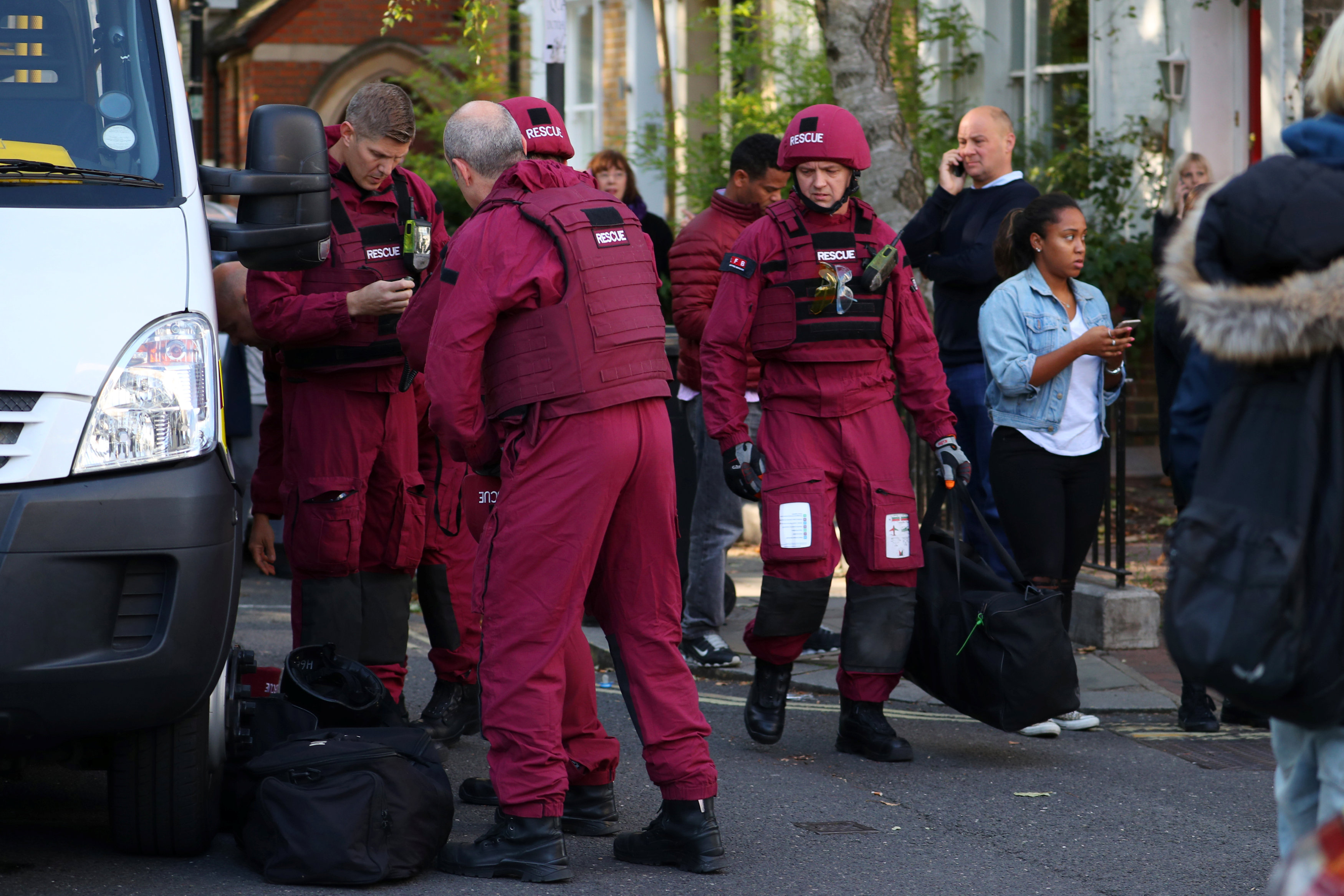 Members of a bomb disposal squad stand in the street near Parsons Green tube station in London, Britain on Sept. 15, 2017. (REUTERS/Hannah McKay)