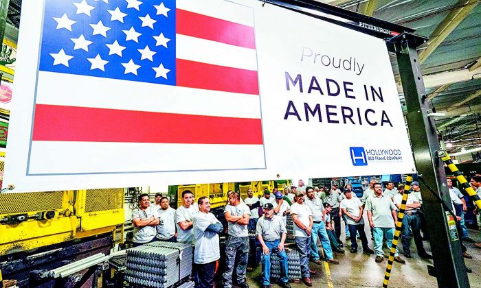 Workers at the Hollywood Bed Frame Co. in Commerce, Calif., attend an event on April 14 to mark the company's expansion, with 100 new local jobs. (ROBYN BECK/AFP/GETTY IMAGES)