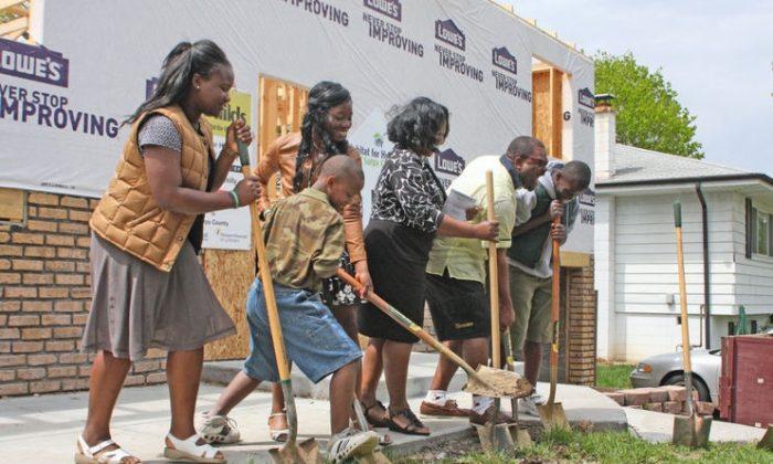 (L-R) Sena, Raoul, Marlene, Nicole, Pierre and Jean Djidjoho participate in the groundbreaking ceremony to celebrate their new home. (photo courtesy of the Papillion Times)