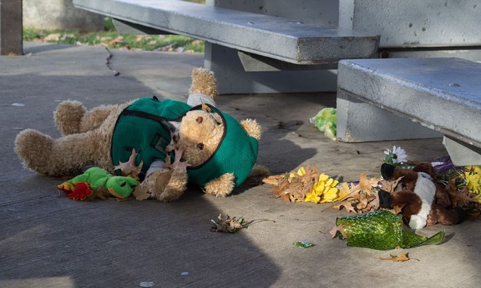 A stuffed animal lays on the ground. (Photo credit should read JORDAN GONZALEZ/AFP/Getty Images)