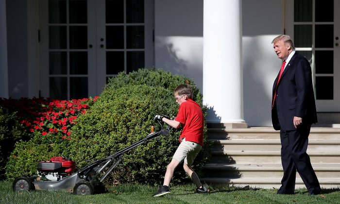 "U.S. President Donald Trump (R) watches as 11-year-old Frank ""FX"" Giaccio (L) mows the grass in the Rose Garden of the White House September 15, 2017 in Washington, DC. Giaccio, from Falls Church, Virginia, who runs a business called FX Mowing, wrote a letter to Trump expressing admiration for Trump's business background and offered to mow the White House grass.  (Win McNamee/Getty Images)"