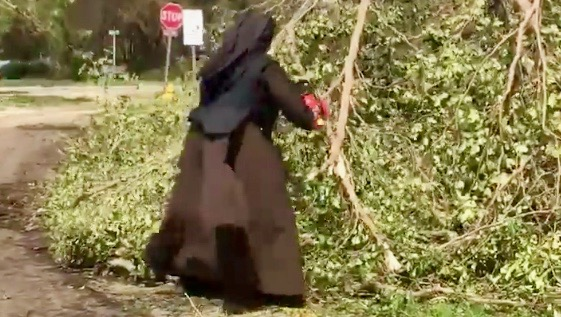 Sister Margaret Ann cutting branches after Hurricane Irma. (Screenshot via Storyful)