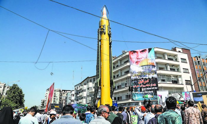 "A Shahab-3 medium-range missile is displayed during a rally marking Al-Quds (Jerusalem) Day in Tehran, Iran, on June 23. Chants against the Saudi royal family and the ISIS terrorist group mingled with the traditional cries of ""Death to Israel"" and ""Death to America."" (STRINGER/AFP/GETTY IMAGES)"