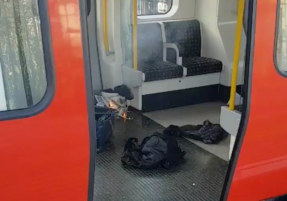 Personal belonglongs and a bucket with an item on fire inside it, are seen on the floor of an underground train carriage at Parsons Green station in West London, Britain September 15, 2017, in this image taken from social media. (Sylvain Pennec/via Reuters)