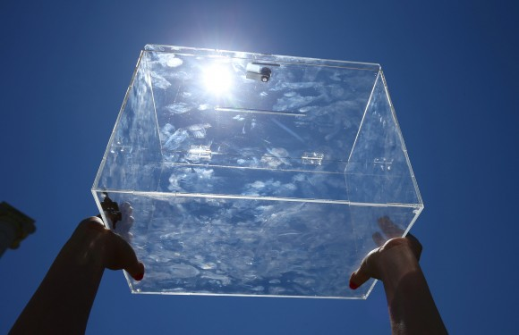 FILE PHOTO - A volunteer shows a ballot box after a pro-independence rally in Barcelona, Spain June 11, 2017. (Reuters/Albert Gea/File Photo)