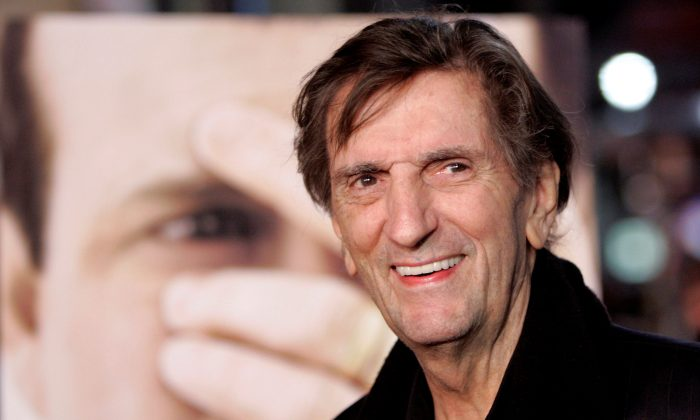 "FILE PHOTO: Cast member Harry Dean Stanton smiles at the premiere of ""Big Love"" at the Grauman's Chinese theatre in Hollywood, California, U.S. on February 23, 2006. (Reuters/Mario Anzuoni/File Photo)"