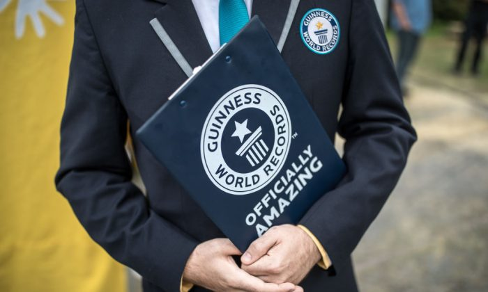 A representative from the Guinness Book of World Records. (Photo by Maja Hitij/Getty Images)