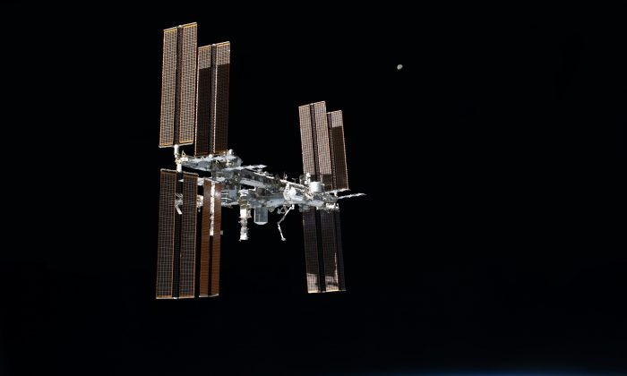 The International Space Station photographed from the space shuttle Atlantis as the orbiting complex and the shuttle performed their relative separation in the early hours of July 19, 2011.  (NASA via Wikimedia Commons)