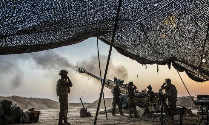 U.S. Soldiers fire a howitzer to support Iraqi forces in northern Iraq on Aug. 15, while supporting Operation Inherent Resolve. (Army photo by Cpl. Rachel Diehm)