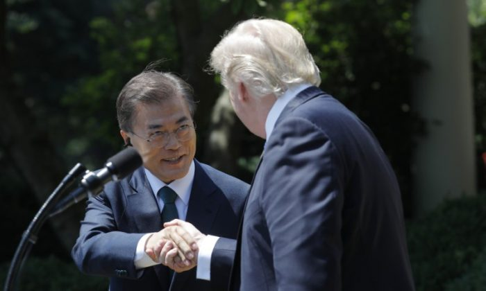 U.S. President Donald Trump  (R) greets South Korean President Moon Jae-in prior to delivering a joint statement from the Rose Garden of the White House in Washington on June 30, 2017. (REUTERS/Carlos Barria)