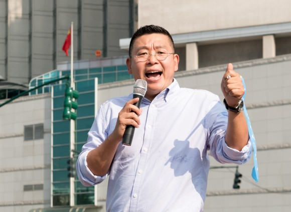 Chinese dissident Yang Jianli gives a speech on Sept. 16 in front of China's Consulate General Office in New York City to protest China's blocking of Taiwan from the United Nations and other international organization. (Paul Huang/The Epoch Times)