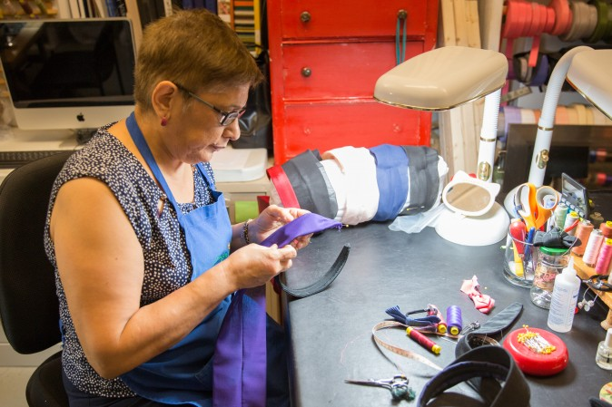 Rosa Pinto makes headbands at the Jennifer Ouellette studio. (Benjamin Chasteen/The Epoch Times)