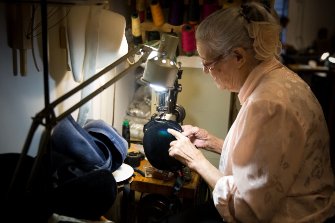 Georgina Sanchez, who has been working in the Garment District for over 40 years, use a sewing machine that is over 100 years old at the Jennifer Ouellette studio. (Benjamin Chasteen/The Epoch Times)