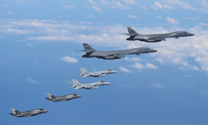 Two U.S. Air Force B-1B Lancer bombers fly from Andersen Air Force Base, Guam, for a mission, with an escort of a pair of Japan Self-Defense Forces F-15 fighter jets and U.S. Marines' F-35B fighter jets in the vicinity of Kyushu, Japan, in this photo released by Air Staff Office of the Defense Ministry of Japan August 31, 2017. (Air Staff Office of the Defense Ministry of Japan/HANDOUT via REUTERS)