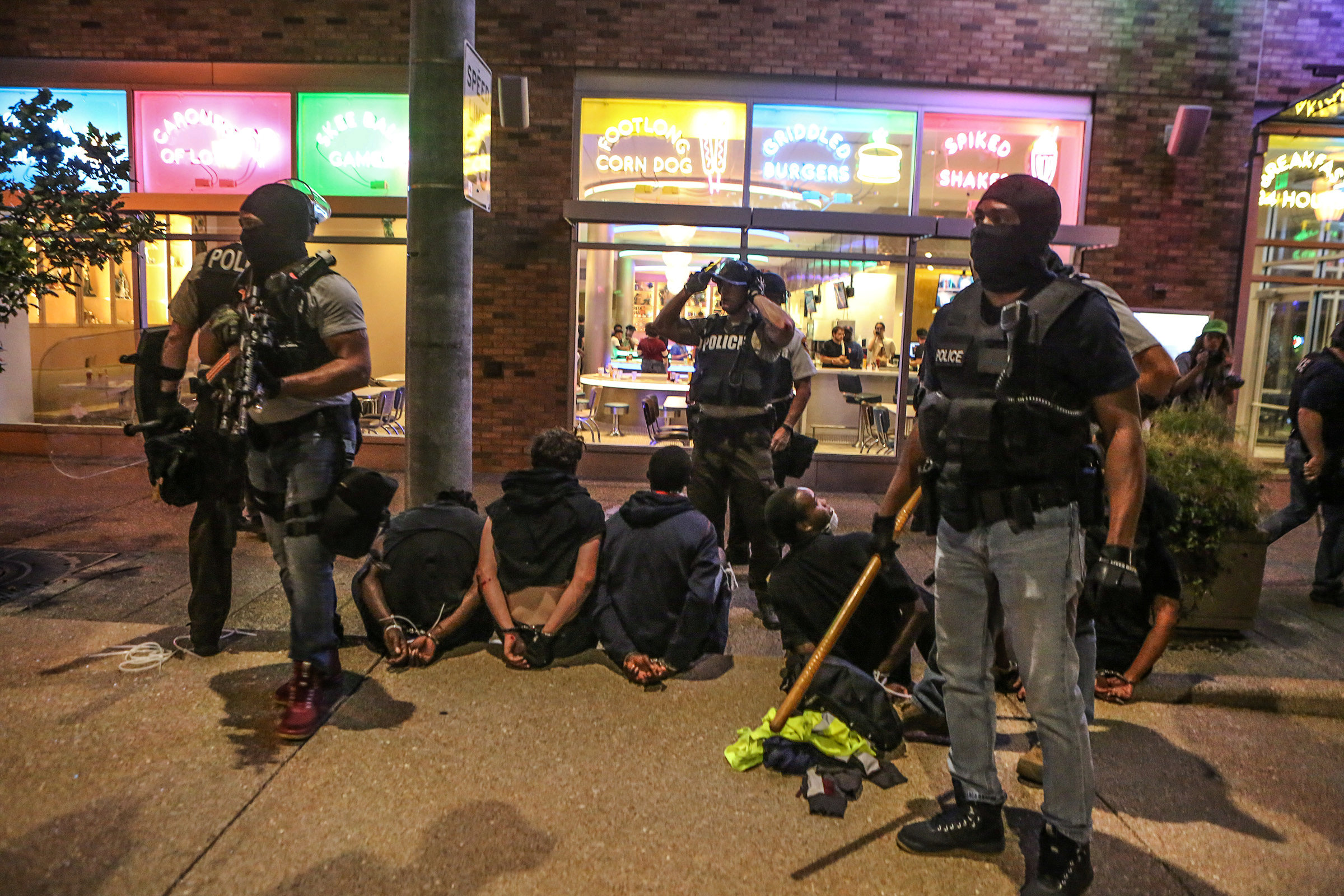 Police detain protesters arrested for causing damage to local businesses during the second night of demonstrations after a not guilty verdict in the murder trial of former St. Louis police officer Jason Stockley, charged with the 2011 shooting of Anthony Lamar Smith, who was black, in St. Louis, Missouri on Sept. 16, 2017. (REUTERS/Lawrence Bryant)