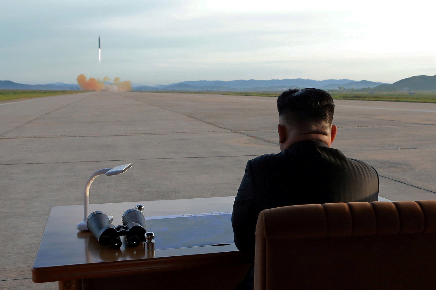 North Korean leader Kim Jong Un watches the launch of a Hwasong-12 missile in this undated photo released by North Korea's Korean Central News Agency (KCNA) on September 16, 2017. (KCNA via REUTERS)