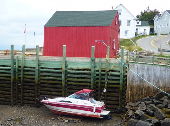 A boat rests on the harbour bottom at low tide in Hall's Harbour. (Manos Angelakis)