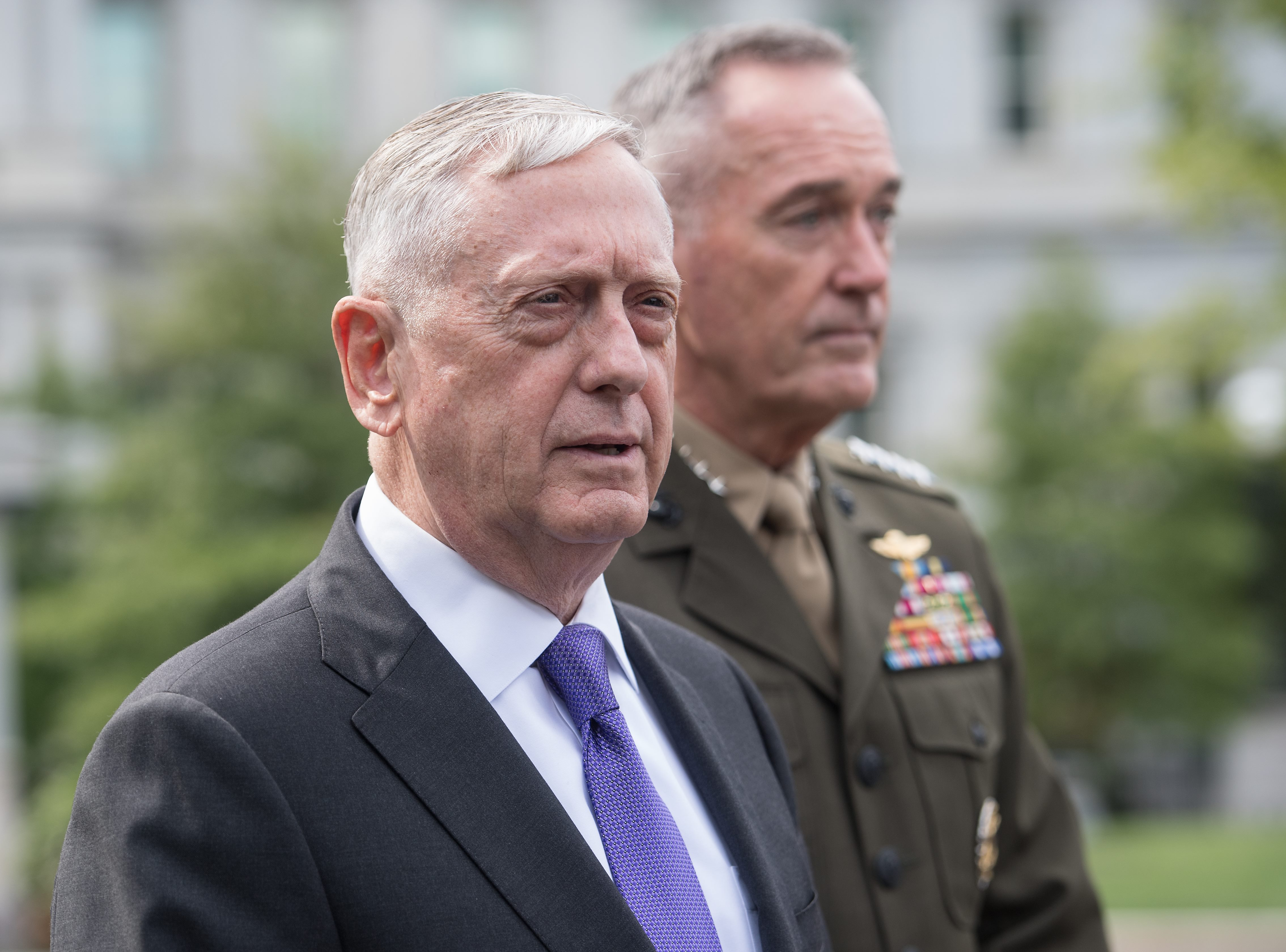 Defense Secretary James Mattis (L) and Gen. Joseph Dunford, chairman of the Joint Chiefs of Staff, arrive to speak to the press about the situation in North Korea at the White House in Washington on Sept. 3, 2017. (NICHOLAS KAMM/AFP/Getty Images)