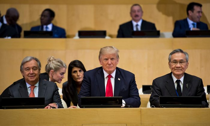 (L-R) UN Secretary General Antonio Guterres (L), President Donald Trump, and Thailand's Foreign Minister Don Pramudwinai at the UN headquarters in New York on Sept. 18, 2017. (BRENDAN SMIALOWSKI/AFP/Getty Images)