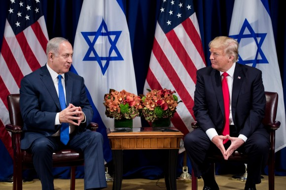 President Donald Trump listens while Israel's Prime Minister Benjamin Netanyahu makes a statement for the press before a meeting at the Palace Hotel during the 72nd session of the United Nations General Assembly in New York on Sept. 18, 2017. (BRENDAN SMIALOWSKI/AFP/Getty Images)