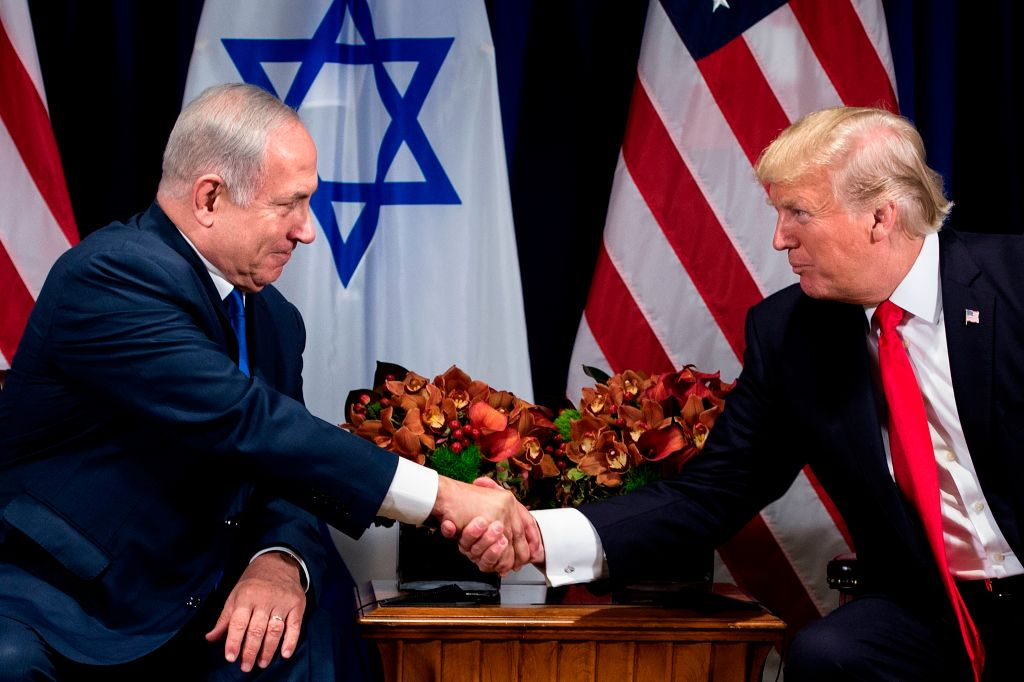 Israel's Prime Minister Benjamin Netanyahu (L) and US President Donald Trump shake hands before a meeting at the Palace Hotel during the 72nd session of the United Nations General Assembly in New York on Sept. 18, 2017. (BRENDAN SMIALOWSKI/AFP/Getty Images)
