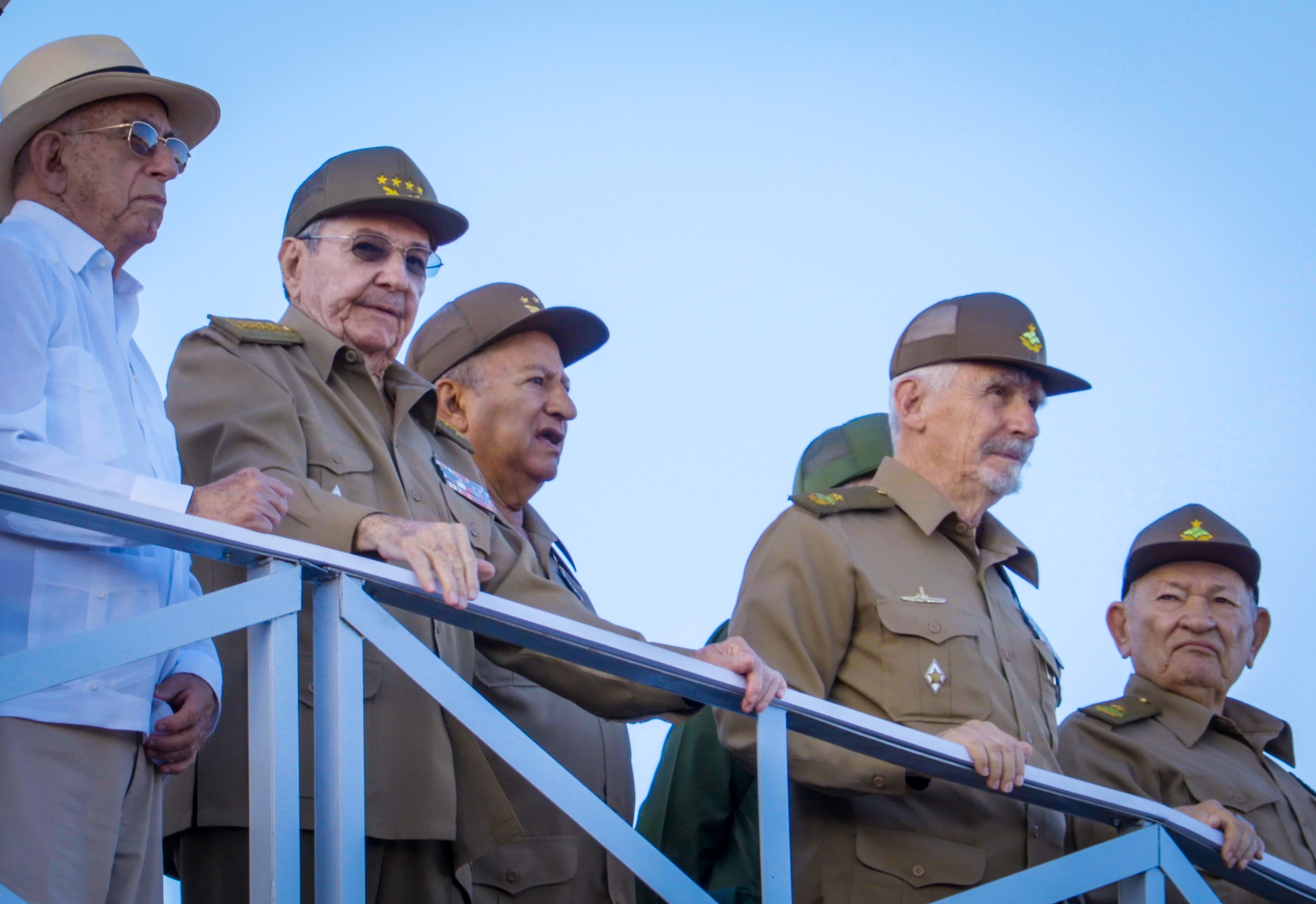 Cuban President Raul Castro (2nd-L), Cuban Vice President Jose Ramon Machado Ventura (L), Minister of the Revolutionary Armed Forces (FAR),General Leopoldo Cintra Frias (3rd-L) and Revolution Commanders, Ramiro Valdez (2nd-R) and Guillermo Garcia Frias (R) participate in a military parade in honor the death of Cuban dictator Fidel Castro at Revolution Square in Havana, on Jan. 2, 2017. (ADALBERTO ROQUE/AFP/Getty Images)