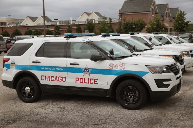 Ford Explorer based Police Interceptors sit in a police station parking lot in Chicago on Aug. 4, 2017. (Scott Olson/Getty Images)