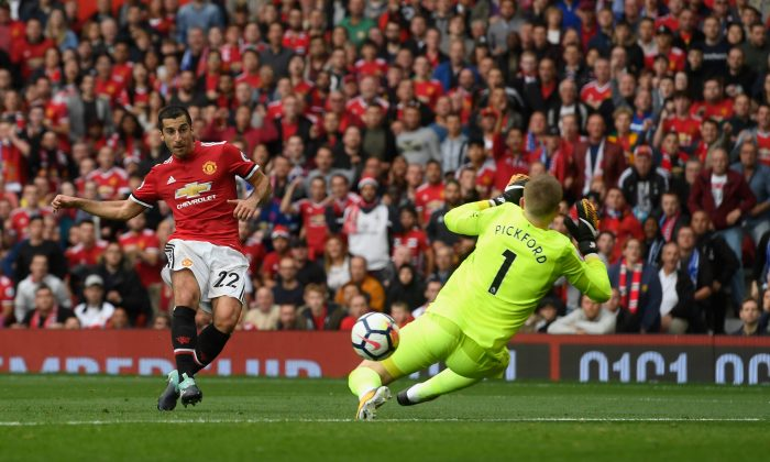 Henrikh Mkhitaryan scores Manchester United's second goal past Jordan Pickford of Everton during the Premier League match between Manchester United and Everton at Old Trafford on September 17, 2017 in Manchester, England. (Stu Forster/Getty Images)