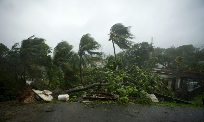 "A picture taken on Sept. 19, 2017 shows the powerful winds and rains of hurricane Maria battering the city of Petit-Bourg on the French overseas Caribbean island of Guadeloupe. Hurricane Maria strengthened into a ""potentially catastrophic"" Category Five storm as it barrelled into eastern Caribbean islands still reeling from Irma, forcing residents to evacuate in powerful winds and lashing rain. (CEDRIK-ISHAM CALVADOS/AFP/Getty Images)"