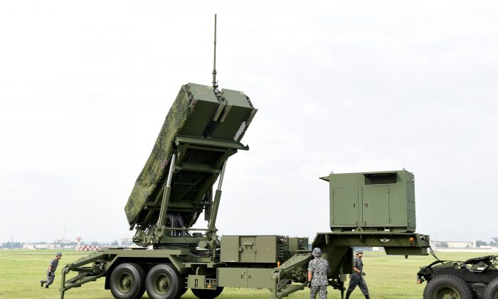 Soldiers from the Japan Air Self-Defense Force set up PAC-3 surface-to-air missile launch systems during a temporary deployment drill at US Yokota Air Base in Tokyo on Aug. 29, 2017. (TORU YAMANAKA/AFP/Getty Images)