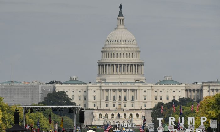 """Demonstrators wave national flags in front of the United States Capitol in a pro-Trump 'Mother of All Rallies' on the National Mall in Washington, D.C. on Sept. 16, 2017. Supporters of President Donald Trump gathered in the US capital to show support of """"free-speech"""" and to celebrate America. (PAUL J. RICHARDS/AFP/Getty Images)"""