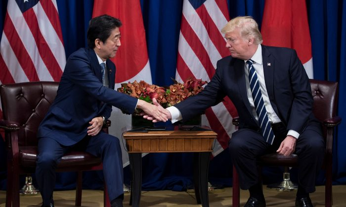 Japan's Prime Minister Shinzo Abe and US President Donald Trump shake hands before a meeting at the Palace Hotel during the 72nd United Nations General Assembly on Sept. 21, 2017 in New York City.     (BRENDAN SMIALOWSKI/AFP/Getty Images)