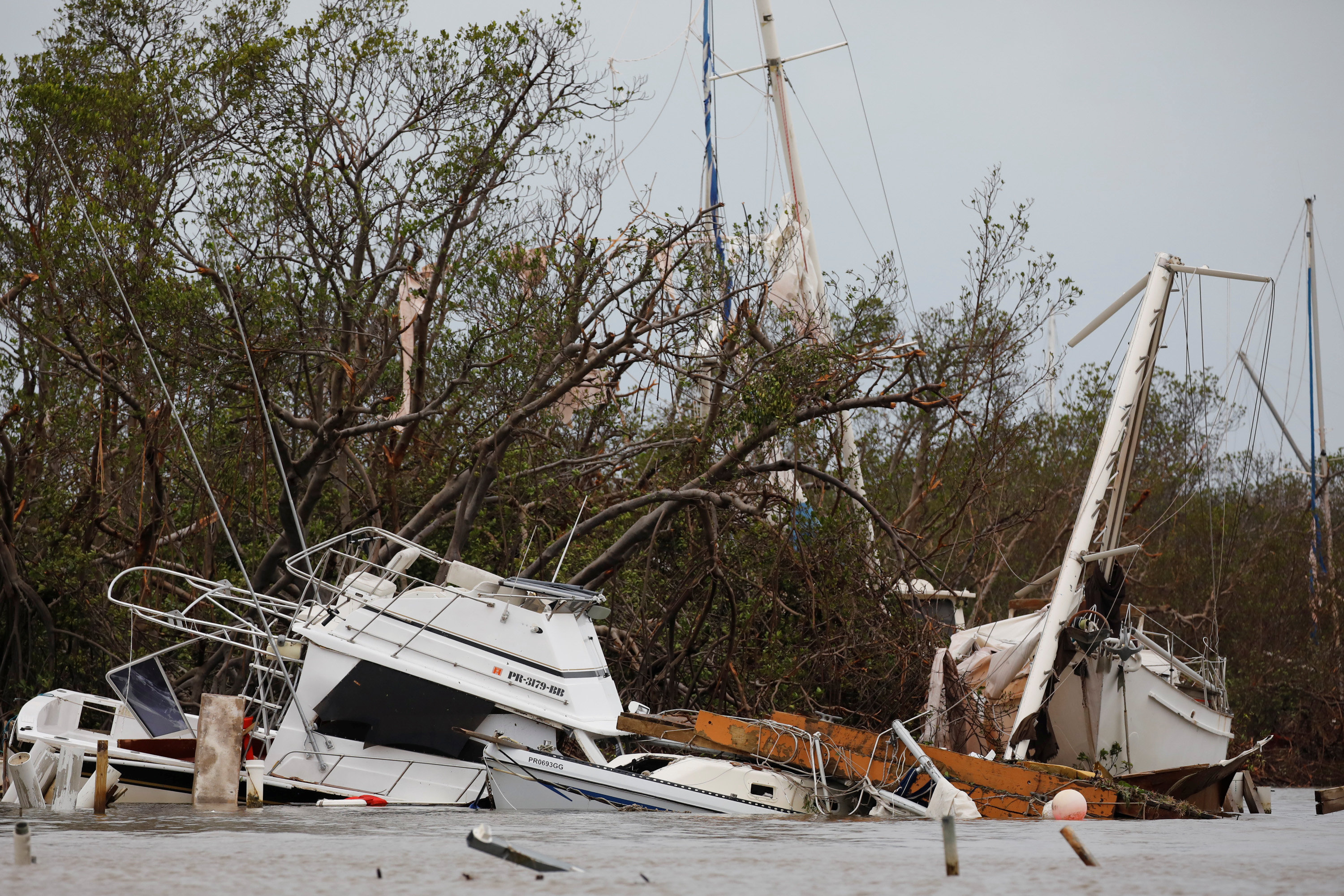 Damaged boats are seen after the area was hit by Hurricane Maria in Salinas, Puerto Rico on Sept. 21, 2017. (REUTERS/Carlos Garcia Rawlins)