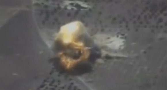 A still image taken from a video footage and released by Russia's Defence Ministry on Sept. 22, 2017, shows a missile hitting a building which Defense Ministry said was a Jabhat al-Nusra target in Syria. (Russian Defence Ministry/Handout via REUTERS TV)
