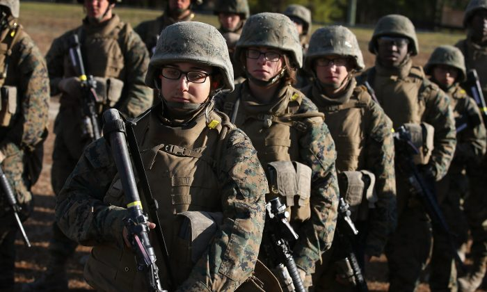 Male and female Marines listen to instructions during a combat marksmanship course at Marine Combat Training (MCT) on February 20, 2013 at Camp Lejeune, North Carolina. (Scott Olson/Getty Images)