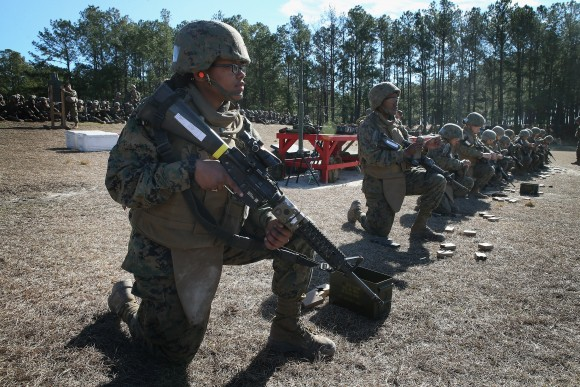 Female and male Marines line up on a firing line during a combat marksmanship course at Marine Combat Training (MCT) on February 20, 2013 at Camp Lejeune, North Carolina. (Scott Olson/Getty Images)
