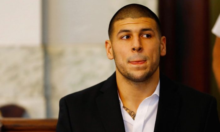 Aaron Hernandez sits in the courtroom of the Attleboro District Court. (Photo by Jared Wickerham/Getty Images)
