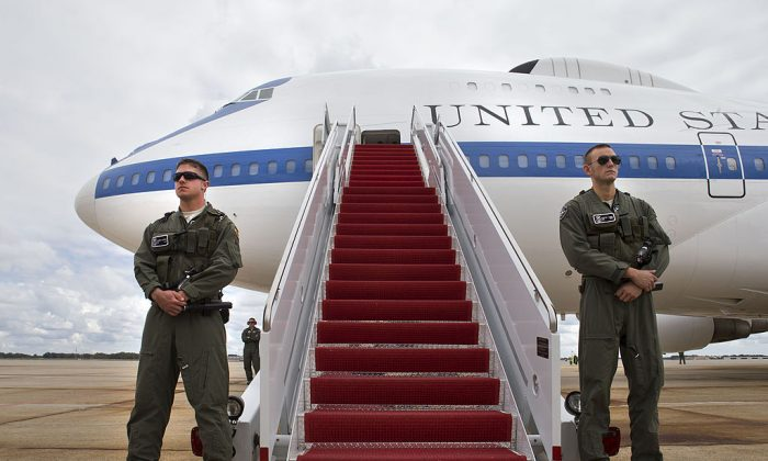 Members of the U.S. Air Combat Command Security Forces guard the E-4B plane. (Photo by Jacquelyn Martin-Pool/Getty Images)